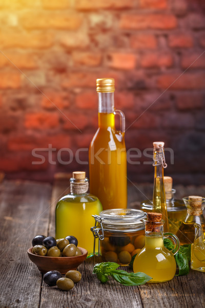 Olive oil in glass bottles and olives Stock photo © grafvision