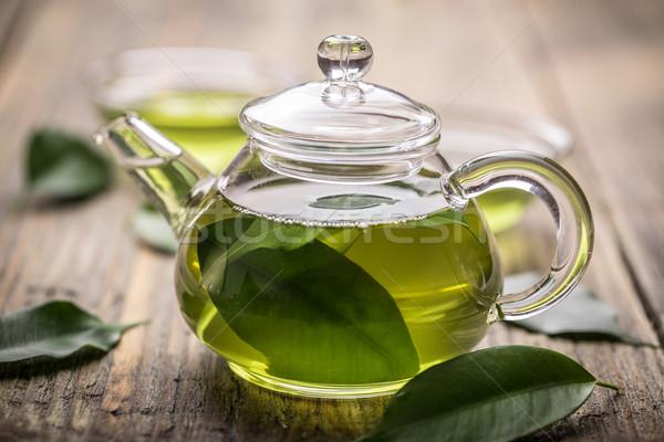 Glas theepot groene thee houten tafel blad drinken Stockfoto © grafvision