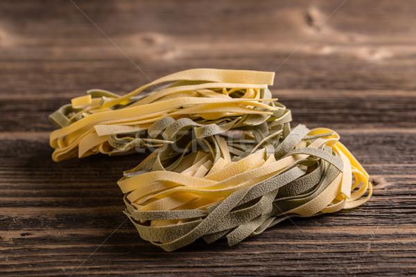 Olasz tészta tagliatelle rusztikus fából készült zöld Stock fotó © grafvision
