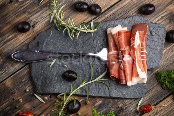 Prosciutto top view fette alimentare Foto d'archivio © grafvision