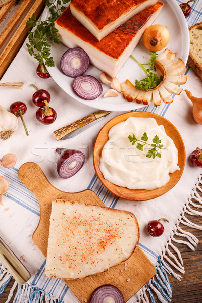 A slice of bread spread with lard was a typical staple in traditional rural cuisine of many countrie Stock photo © grafvision
