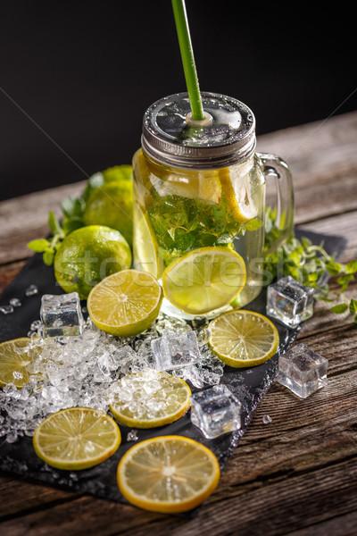 Limonádé jég üveg szalmaszál levél háttér Stock fotó © grafvision