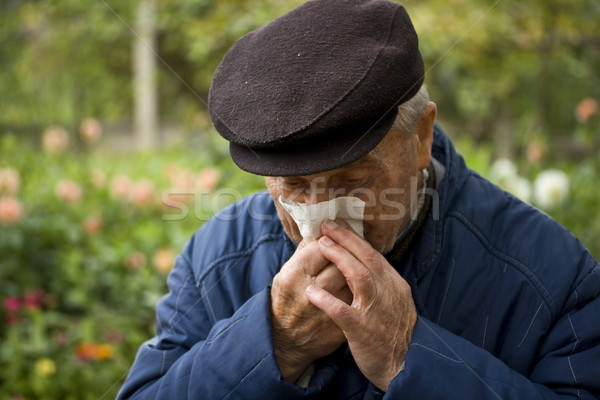 old man blowing his nose Stock photo © grafvision