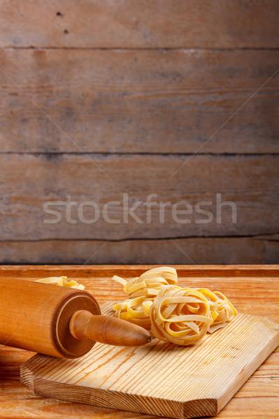 Makarna tagliatelle ahşap pin haddeleme arka plan pişirmek Stok fotoğraf © grafvision