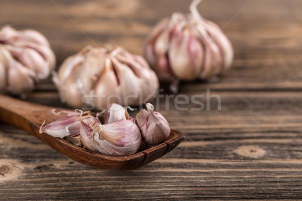 Fokhagyma szegfűszeg fakanál fa konyha főzés Stock fotó © grafvision