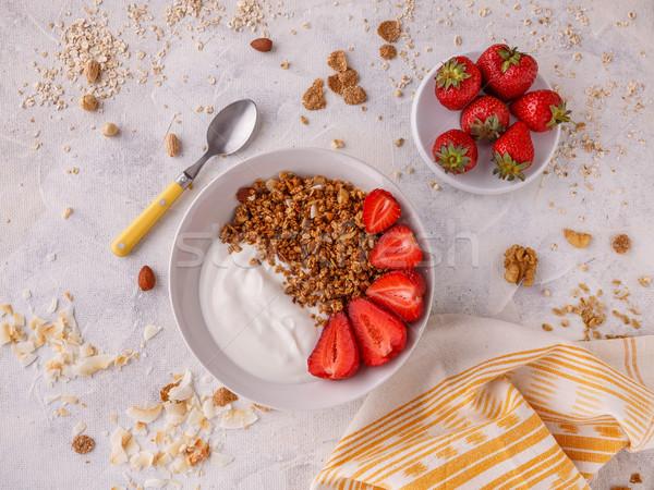 Saboroso granola iogurte fresco morangos branco Foto stock © grafvision