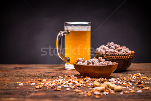 Beer and roasted peanuts Stock photo © grafvision