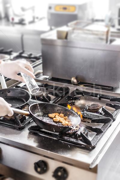 Chef doing flambe Stock photo © grafvision