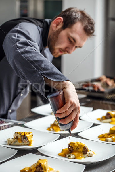 Chef finishing his plate Stock photo © grafvision