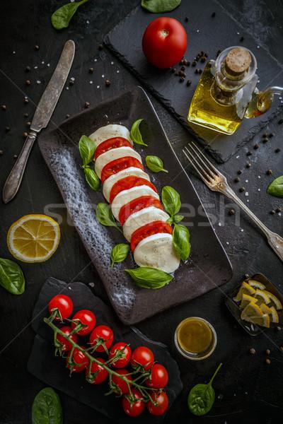 Delicious caprese salad Stock photo © grafvision