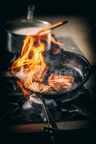 Flame in black pan Stock photo © grafvision