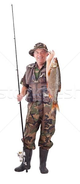 Senior pescador isolado branco peixe Foto stock © grafvision