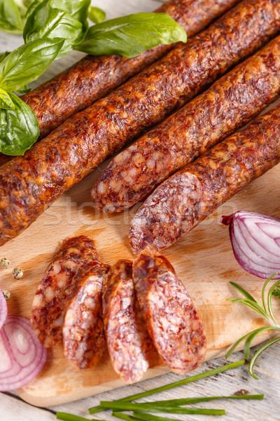 салями копченый колбаса разделочная доска фон Сток-фото © grafvision