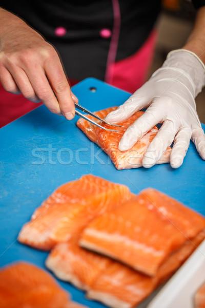 Chef removing fish bone Stock photo © grafvision