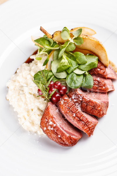 Roast goose breast on white plate, fine dining Stock photo © grafvision