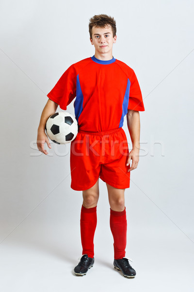 Futbolcu gri futbol top kırmızı genç Stok fotoğraf © grafvision