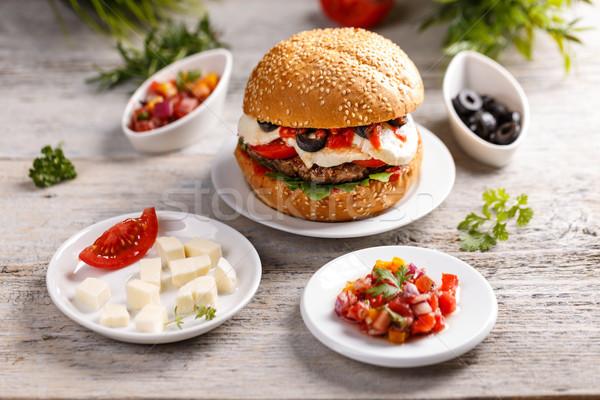 Stockfoto: Smakelijk · gegrild · rundvlees · hamburger · kaas · geschilderd