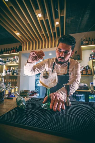 Bartender is stirring cocktail Stock photo © grafvision