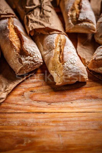 Francia kenyér bagettek rusztikus fából készült fa háttér Stock fotó © grafvision