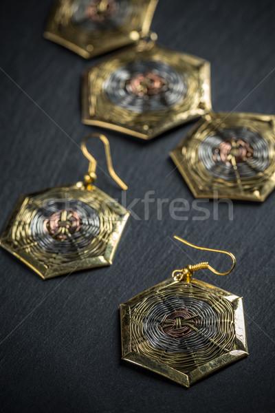 Elegant metal earrings Stock photo © grafvision