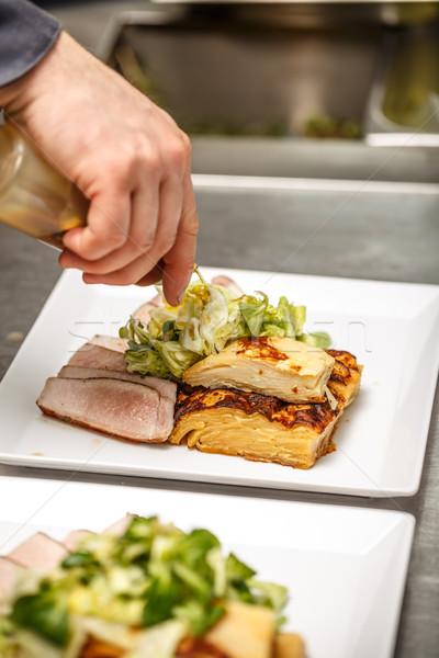 Chef decorating tenderloin  Stock photo © grafvision