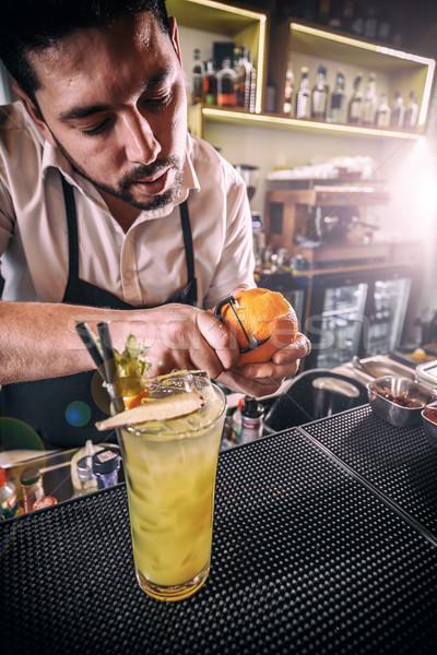 Bartender peeling an orange Stock photo © grafvision