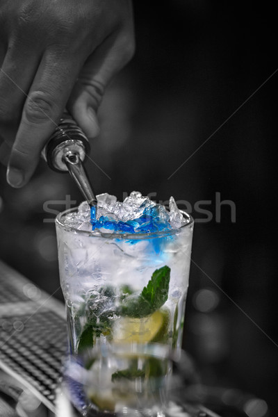 Bartender is pouring blue syrup Stock photo © grafvision