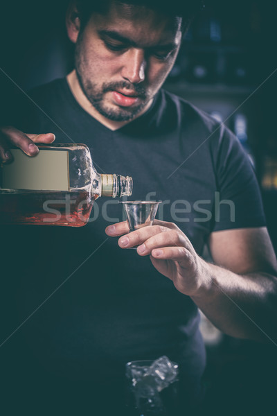 Barman is pouring alcoholic drink Stock photo © grafvision