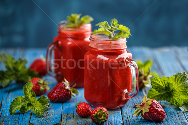 Strawberry smoothie in the glass jars Stock photo © grafvision