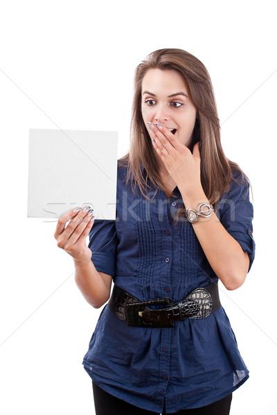 şaşırmış genç kadın bakıyor boş kart portre yalıtılmış Stok fotoğraf © grafvision
