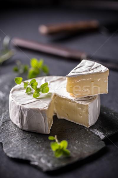 Camambert yumuşak peynir karanlık arka plan kesmek Stok fotoğraf © grafvision