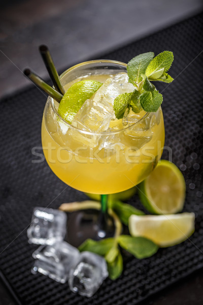 Cocktail garnished with a lime slice and mint leaf Stock photo © grafvision