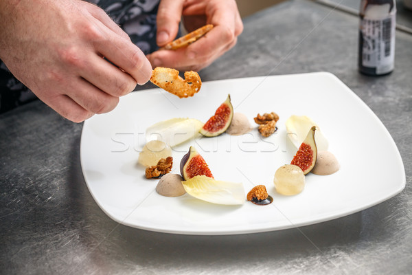 Chef aperitivo placa cocina alimentos frutas Foto stock © grafvision