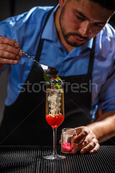 Bartender preparing cocktail Stock photo © grafvision