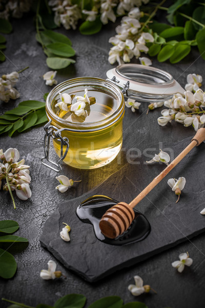 Honey in jar with honey dipper Stock photo © grafvision