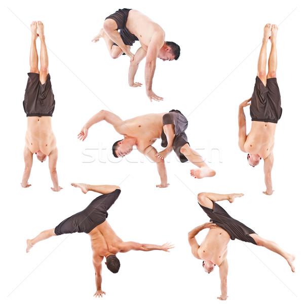 Jeune homme acrobatie gymnastique isolé studio Photo stock © grafvision