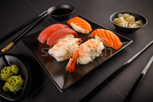 Salmon, tuna and peawn sashimi sushi rolls served with wasabi, ginger and soy sauce Stock photo © grafvision