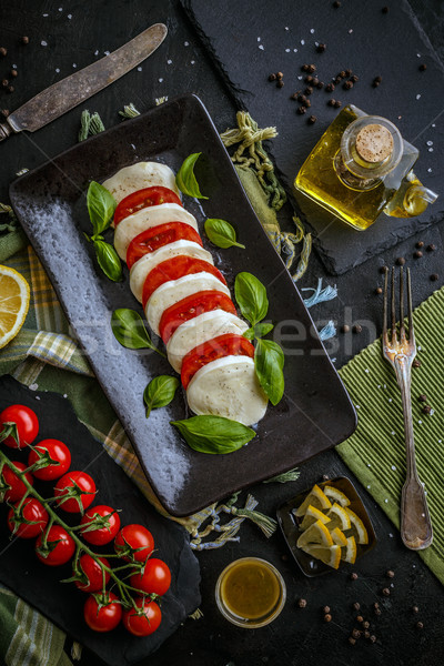 Lezzetli caprese salatası natürmort siyah peynir plaka Stok fotoğraf © grafvision