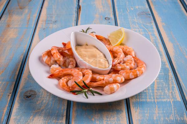 Molho limão alecrim prato azul frutos do mar Foto stock © grafvision