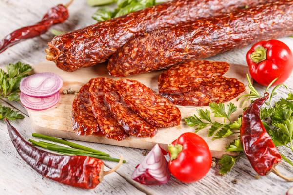 Szeletek szalámi kolbász fából készült vágódeszka hús Stock fotó © grafvision