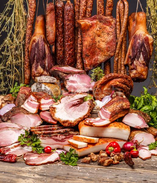 Füstölt disznóhús hús csendélet különböző kolbászok Stock fotó © grafvision