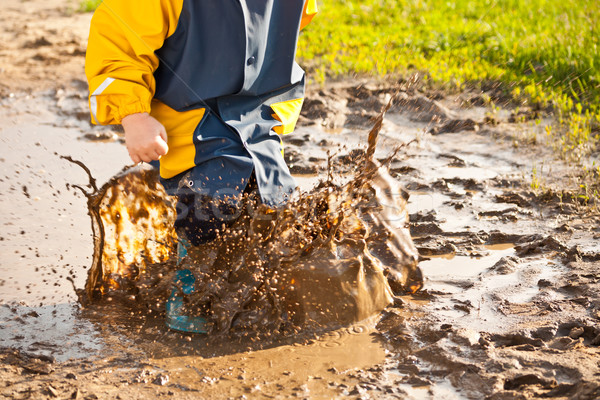 Child splashing in puddle Stock photo © grafvision