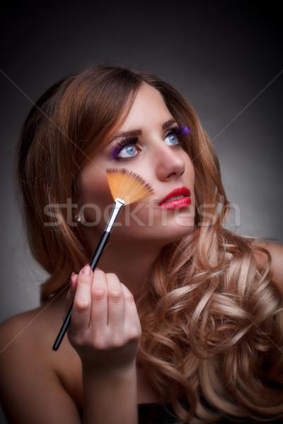 Fiatal nő sminkecset szépség portré szürke arc Stock fotó © grafvision