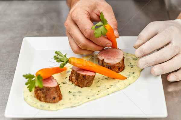 Chef decorating a pork tenderloin  Stock photo © grafvision