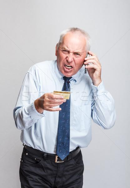 Agacé affaires parler cellulaires affaires téléphone Photo stock © grafvision