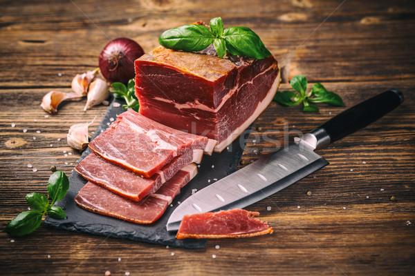 Szeletek prosciutto öreg fából készült étel háttér Stock fotó © grafvision