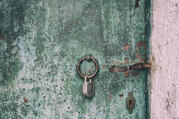 Rozsdás fémes ajtó rongyos öreg festék Stock fotó © grafvision