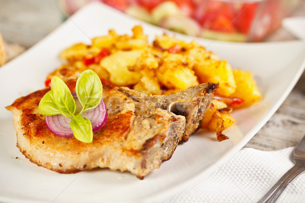 Disznóhús vesepecsenye étel zöldség krumpli senki Stock fotó © grafvision