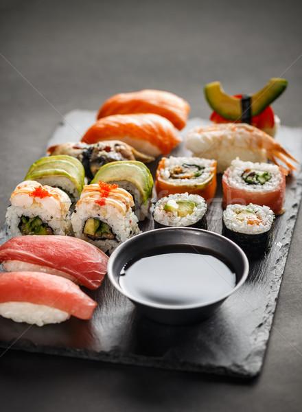 Sushi ayarlamak sashimi hizmet taş Stok fotoğraf © grafvision