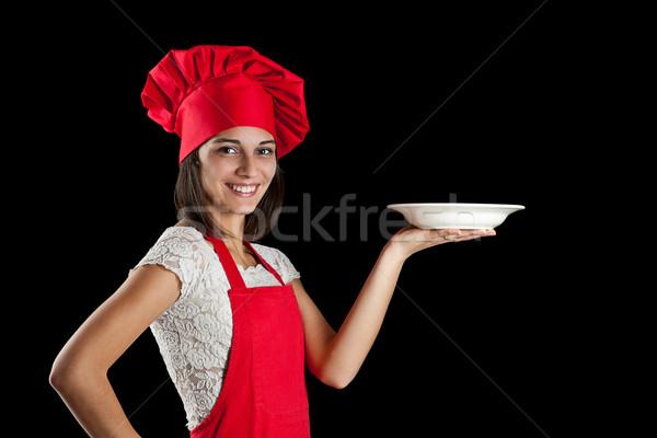 Szakács mutat tányér portré női egyenruha Stock fotó © grafvision